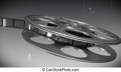 Film reel against black and white background - Digitally...