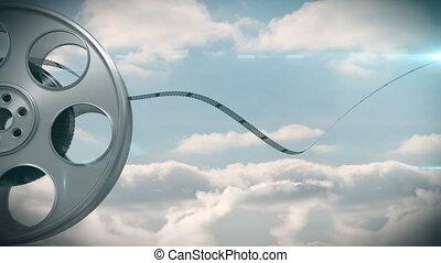 Film reel against sky background - Digitally generated of ...