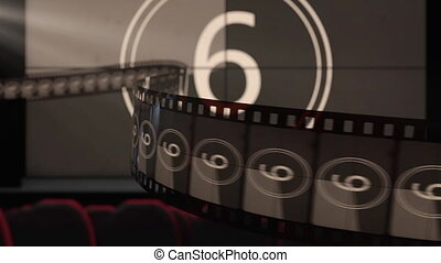 Film strip against cinema screen with old fashioned countdown movie