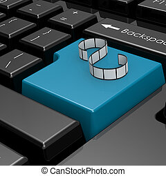 Film strip on blue button of computer keyboard