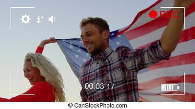 Filming a couple on a beach on a digital camera 4k