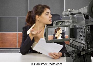 Filming Female Reporter - camera view of a female reporter...