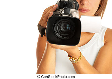 filming - young woman with camcorder, selective focus on...