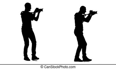 Filmmaker steps with the camera on his shoulder. White background. Silhouette. Side view. 2 in 1.