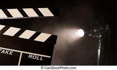 Filmmakers clapperboard, studio light on background -...
