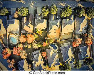 Filtered image aerial view typical house with light snow covered roof in cold fall morning