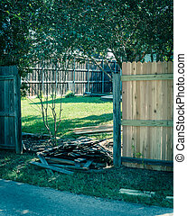Filtered image aged wooden fence near new lumber boards installation of suburban residential house in Texas, USA
