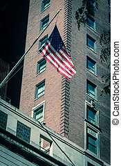 Filtered image waving American flag on federal buildings in ...