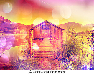 Filtered. Old wooden ship house at scenic Lake. Silent bay