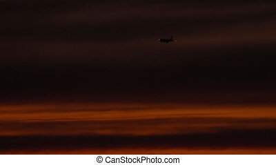 Final approach at sunset - The aircraft on the final...
