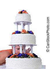 Final Retouching Ruffled Wedding Cake