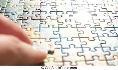 Final step to whole picture. Background of jigsaw puzzle. Last jigsaw puzzle finding its place. Last jigsaw piece of puzzle placed to complete the picture. Final exam, final work. Conceptual