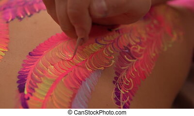 Final touches of an artwork - Artist fulfils lines with a...