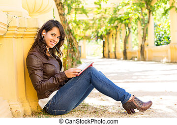 Finally ! A day off! - Young woman reading a book and...