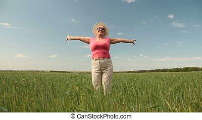 Finally Retired! - Joyful senior woman enjoying retirement...