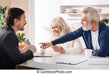 Finance advisor meeting with elderly couple of clients