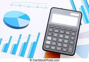 finance business calculator on chart printed documents