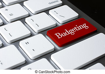Finance concept : Budgeting on white keyboard