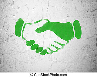 Finance concept: Handshake on wall background