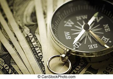 finance concept - money and compass, selective focus on ...