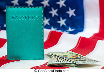 Finance concept passport, money on the national flag of the United States close-up objects