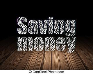 Finance concept: Saving Money in grunge dark room - Finance...