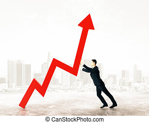 Finance concept - Side view of young businessman pushing red...