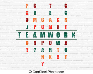 Finance concept: Teamwork in Crossword Puzzle