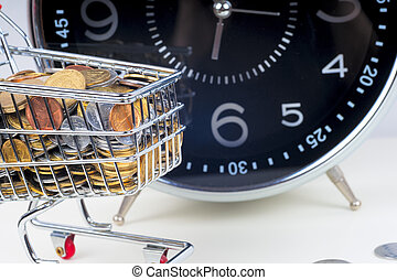 Finance Conceptual, Coins in shopping trolley
