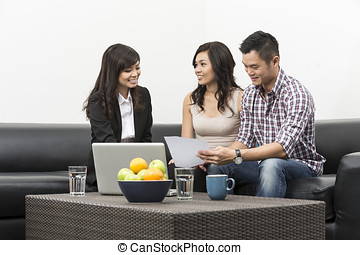Finance Consultant showing investment plans to Asian couple