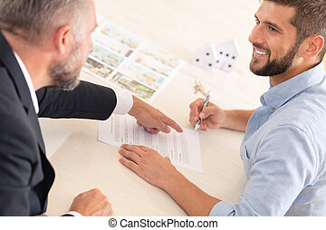 Finance consultant showing mortgage contract