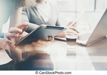 Finance department working process.Picture woman showing business report modern tablet,diagram screen.Banker man holding pen for signs document,discussion startup idea.Horizontal.Film and bokeh effect