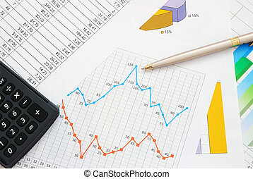 Finance documents with pen and calculator