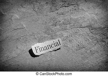 Finance headline - torn newspaper headline with Financial...