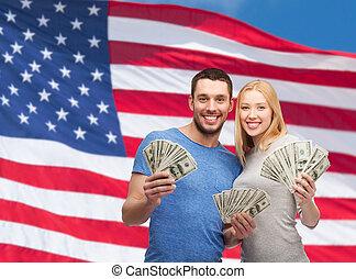 smiling couple holding dollar cash money - finance, money...