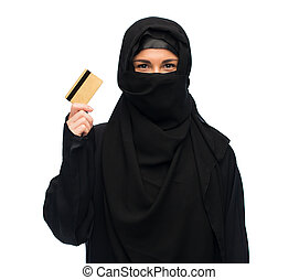 muslim woman in hijab with credit card over white - finances...