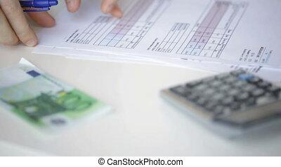 close up of man checking bills - finances, business, economy...