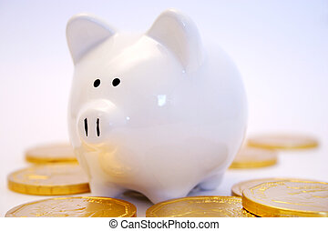 Finances - Piggy bank and gold coins