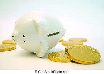 Finances - Piggy bank and gold coins