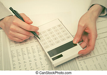 Financial accounting business woman using calculator