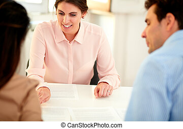 Financial advisor lady explaining application form -...