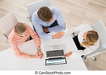 Financial Advisor Shaking Hands With Couple - High Angle...