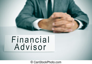 financial advisor - a man wearing a suit sitting in a desk...