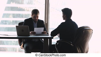 Financial advisor trader giving investment consultation to young businessman.