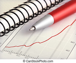 Financial Analysis - ballpoint pen and notebook on financial...