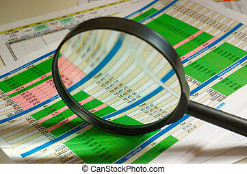 financial analysis - Magnifier  atop of the diagram