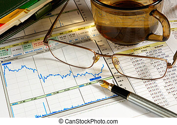 financial analysis -  glasses atop of the diagram and table