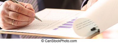 Financial Auditor Signing Calculating Document