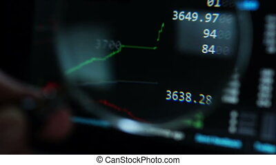 Online stock exchange view through magnifier. - Financial...