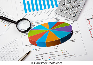 financial charts and graphs on the table